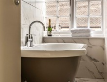 Enjoy your free Prosecco whilst on a Cromer Hotel special offer break  in one of our open ended roll top baths